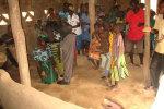 Praying for the sick at Kamanga village