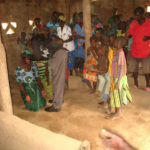 Praying for the sick at Kamanga village